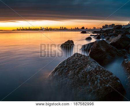 evening landscape sea and city skyline on the horizon
