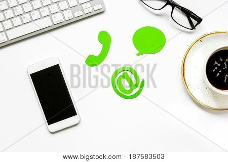 client support service workdesk with mail signs and mobile on white background top view mockup