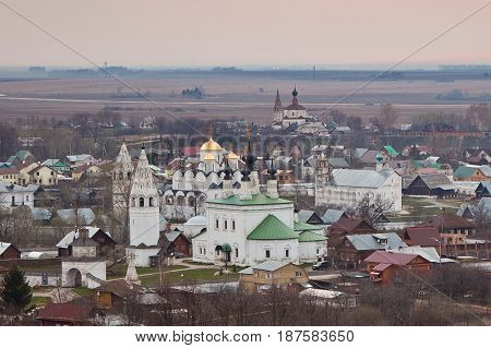 Evening old Suzdal cityscape from rooftop. Pokrovsky women's monastery and old houses