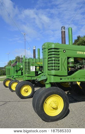 YANKTON, SOUTH DAKOTA, August 19, 2106: The restored  row of John Deere A tractors are displayed at the annual Riverboat Days celebrated the third weekend of August in Yankton.