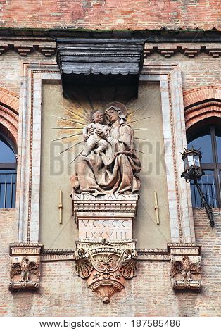 Virgin Mary and Jesus Christ detail on facade in Bologna, Italy
