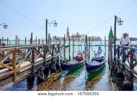 VENICE,ITALY-May 18, 2017.Tourists on water street with Gondola in Venice on May 18,2017. its entirety is listed as a World Heritage Site, along with its lagoon.VENICE,ITALY