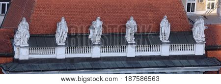 ZAGREB, CROATIA - MAY 31: Statues on top of the old city buildings on Ban Jelacic Square in Zagreb, Croatia on May 31, 2015