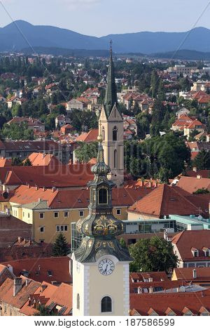 ZAGREB, CROATIA - MAY 31: The towers of the church of St. Mary and St. Francis of Assisi with roofs in the background in Zagreb, Croatia on May 31, 2015