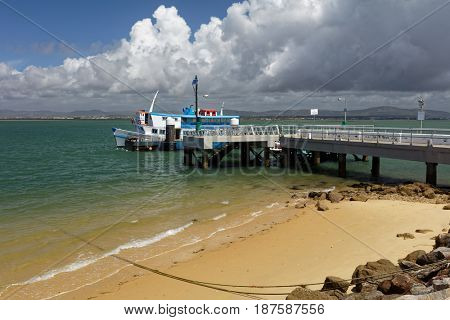 CULATRA ISLAND, ALGARVE, PORTUGAL - MAY 12, 2017: Ferry boat arrived to the island from Faro. The island has an extensive beach on its ocean side, and lagoon side is popular for yachting