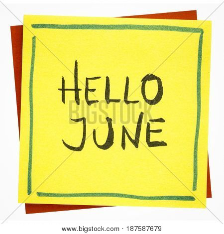 Hello June greetings - handwriting on an isolated sticky note