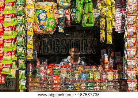 Jaisalmer, India - March 3, 2016: Unidentified indian vendor looking from  his street shop in Jaisalmer, India