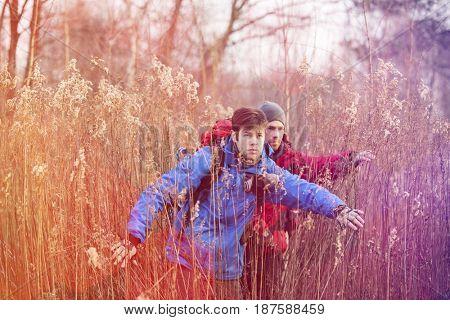 Male backpackers in field