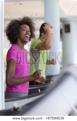 young people exercisinng a cardio on treadmill running machine in modern gym