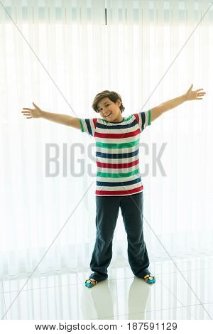 Happy boy at living room of hotel apartment
