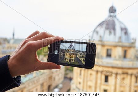 OXFORD/ UK- OCTOBER 26 2016: Tourist Taking Photo Of Radcliffe Camera In Oxford On Phone