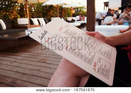 BARCELONA - JULY 29, 2016: Customer holds La Isabela Hotelâ??s rooftop bar menu, mid section