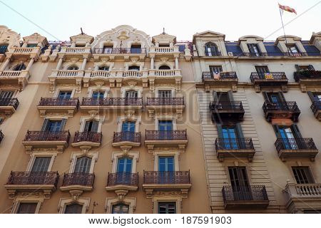 BARCELONA - JULY 29, 2016: Turn of the century building facades in the Gothic Quarter, low angle view