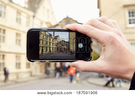 OXFORD/ UK- OCTOBER 26 2016:Tourist Photographing Bridge Of Sighs In Oxford On Mobile Phone