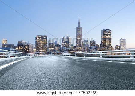 empty road with landmark buildings in san francisco at twilight