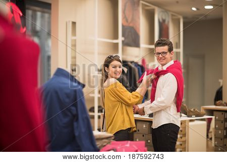 Attractive Couple Shopping In A Man's Clothing Store