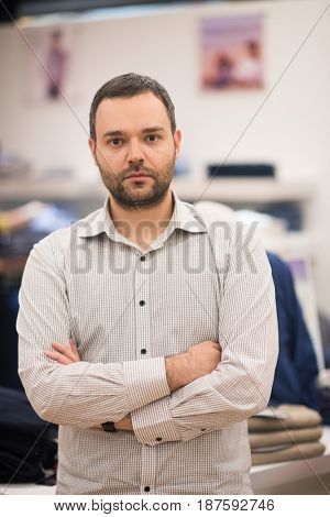 Portrait of an attractive man Shopping In A Man's Clothing Store