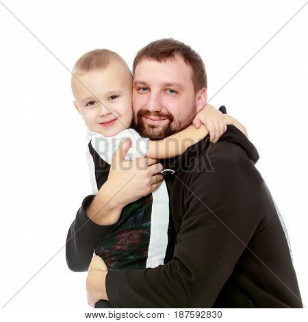 little boy who loves to play football embraces his beloved father.Isolated on white background.