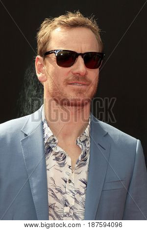 LOS ANGELES - MAY 17:  Michael Fassbender at the Ridley Scott Hand and Foot Print Ceremony at the TCL Chinese Theater on May 17, 2017 in Los Angeles, CA