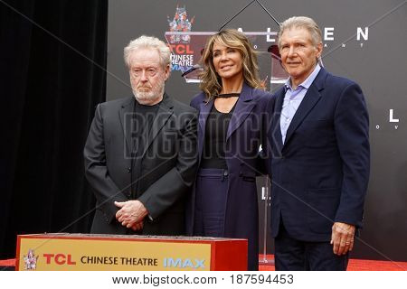 LOS ANGELES - MAY 17:  Ridley Scott, Giannina Facio, Harrison Ford at the Ridley Scott Hand and Foot Print Ceremony at the TCL Chinese Theater on May 17, 2017 in Los Angeles, CA