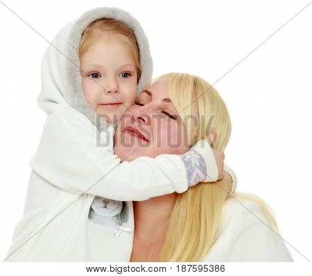Cute little girl tenderly embraces the neck of his beloved mother.Isolated on white background.