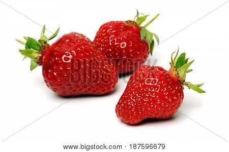 three ripe strawberries