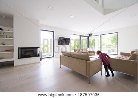 cute little girl playing in a luxury living room