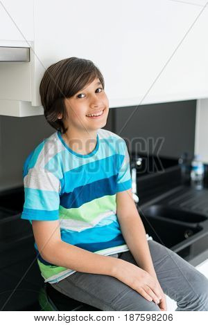 Beatiful kitchen in hotel apartment with boy sitting