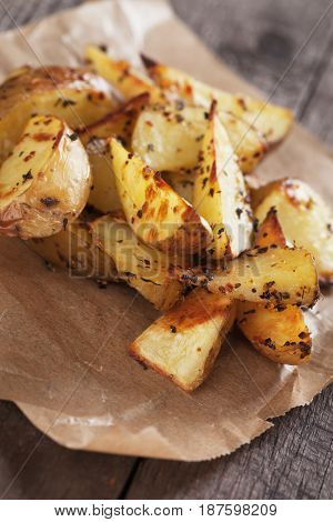 Spicy roasted potato wedges served in parchment paper