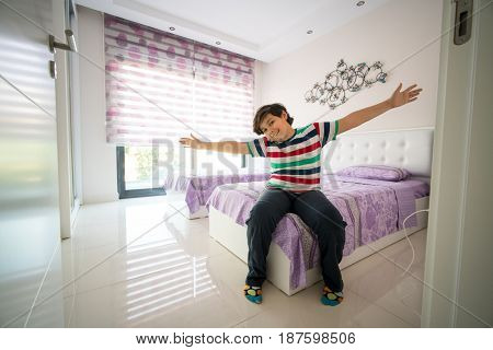 Happy child at new modern apartment bedroom