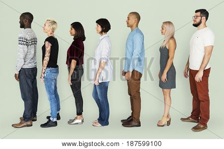 Group of People Standing Line Up Together