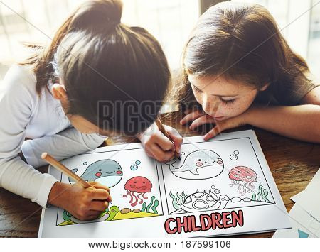Children working on book network graphic overlay