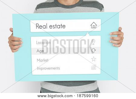 People holding board about real estate word