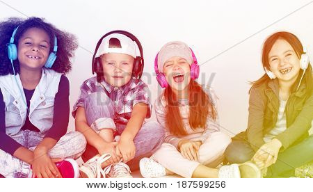 Group of children sitting and hanging out