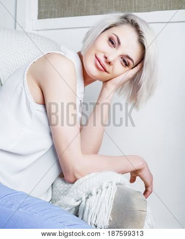 beautiful young model on the chair at home