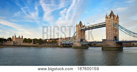 Tower of London and Tower Bridge panorama in early evening light. London, UK.