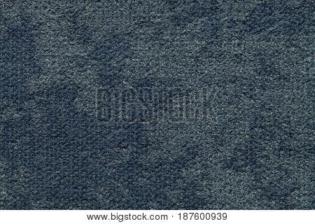 Navy blue background of soft fleecy cloth. Texture of light dark denim nappy textile closeup.