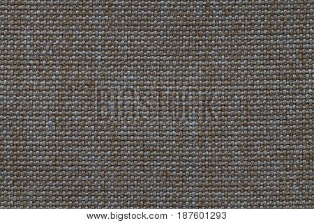 Dark brown and blue woolen background of dense woven bagging fabric closeup. Structure of the bronze cloth with natural texture. Cloth backdrop.