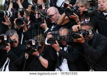 Photographer attends the 'The Killing Of A Sacred Deer' screening during the 70th Cannes Film Festival at Palais des Festivals on May 22, 2017 in Cannes, France.