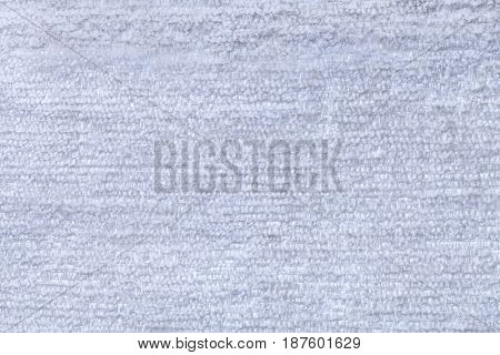 Sky blue fluffy background of soft fleecy cloth. Texture of light cerulean nappy textile closeup.