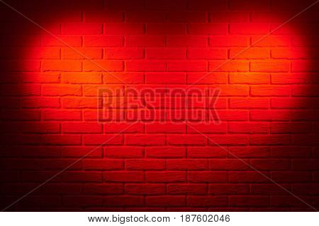 dark red brick wall with heart shape light effect and shadow, abstract background photo