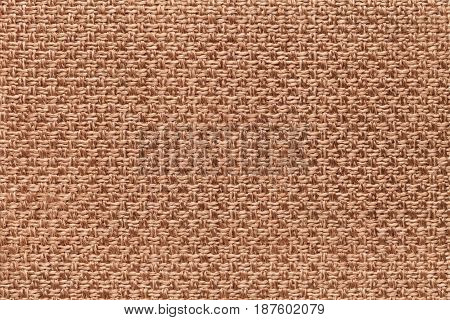 Light brown background with checkered pattern closeup. Structure of the bronze fabric macro.