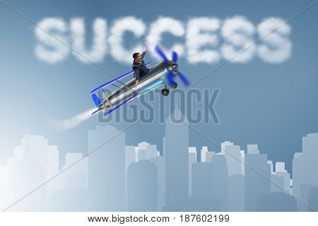 Businessman flying on airplane in success concept