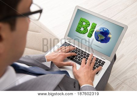 Businessman with laptop in bio concept
