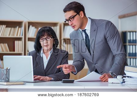 Businesspeople having business discussion in office