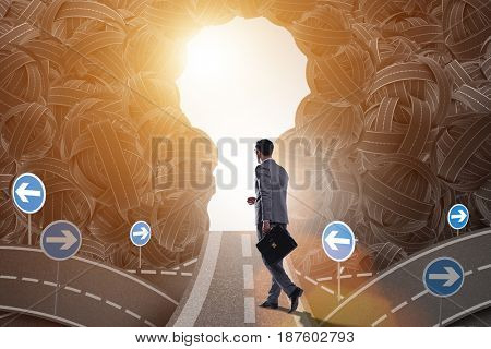 Businessman walking towards his ambition goal concept