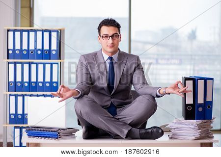 Businessman meditating in the office