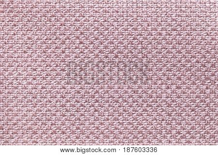 Light pink background with checkered pattern closeup. Structure of the rose fabric macro.