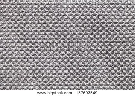 Light gray background with checkered pattern closeup. Structure of the silver fabric macro.