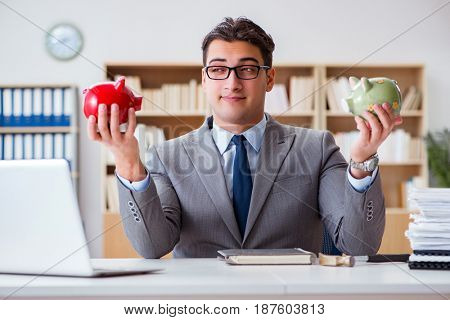 Businessman breaking piggybank in the office